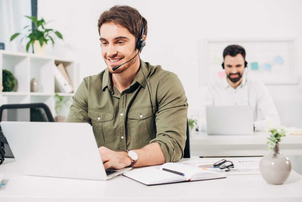 Selective focus of young operator in headset working in modern call centre